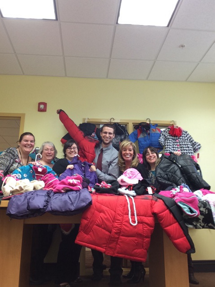 SIS Bank's South Sanford branch staff display some of the 45 coats they have purchased to donate to Coats for Kids.  From left are Sara Hammond, Debbra Springer, Katie Tarbox, Joey L'Heureux, Dee Richard and Theresa Jodway. Photo courtesy Deb Mullen
