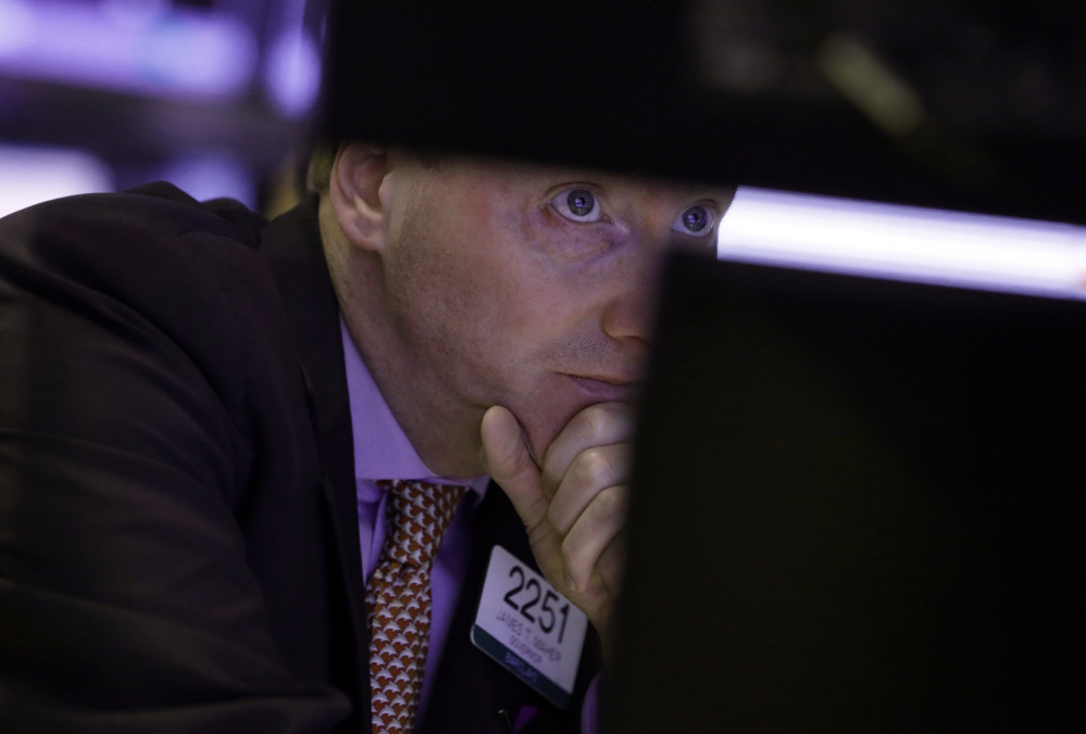 James Maher works on the floor of the New York Stock Exchange on Monday. Stocks rose with gains from Asian markets.