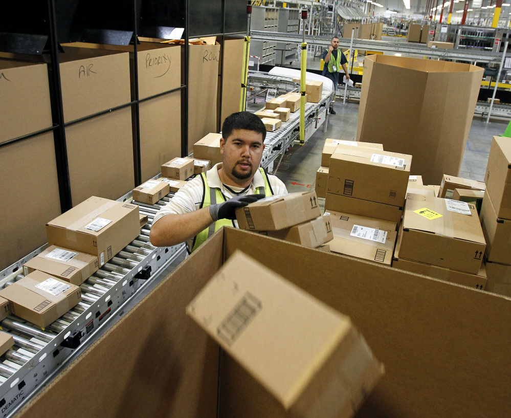 Ricardo Sandoval sorts packages at an Amazon.com center in Phoenix in 2010. Merchants are working hard to make same-day delivery a reality.