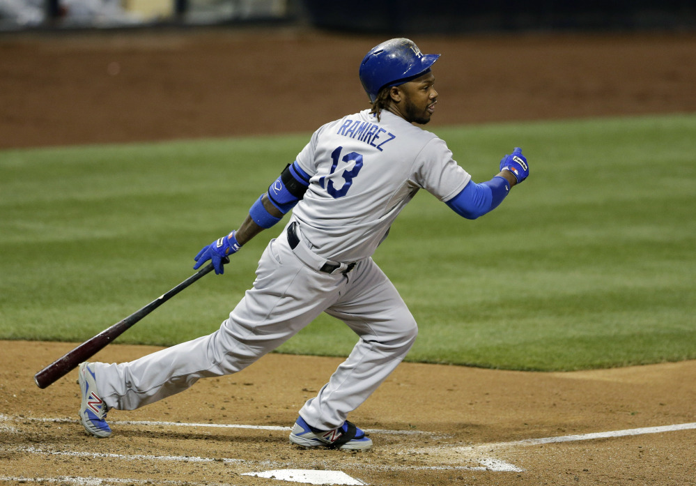 Los Angeles Dodgers' Hanley Ramirez follows through after hitting an RBI-double against the San Diego Padres.