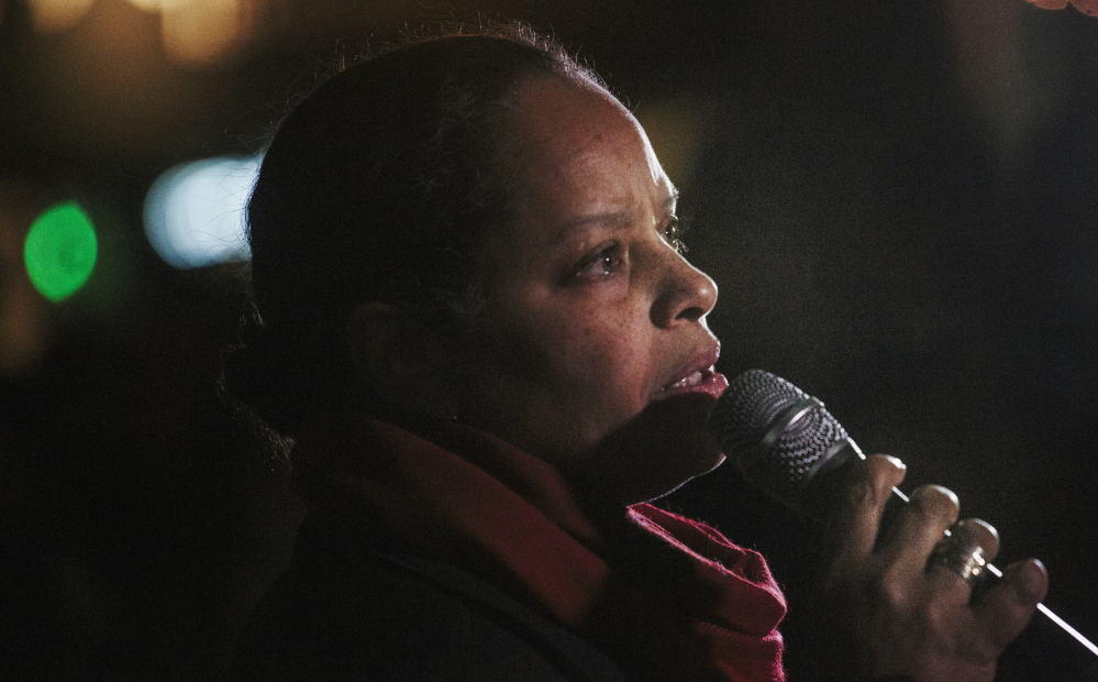 """Maine NAACP director Rachel Talbot Ross, reading """"What Shall I Tell My Children Who Are Black,"""" was one of the speakers in Monument Square on Tuesday night addressing events in Ferguson, Mo."""