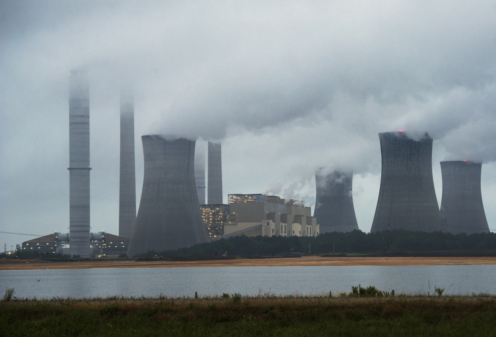 Coal-fired plants, like this one in Juliette, Ga., are subject to new rules as the EPA hopes to cut carbon dioxide emissions by nearly a third over the next 15 years. The rules also govern chromium, arsenic, acid gases, nickel, mercury and other toxins.