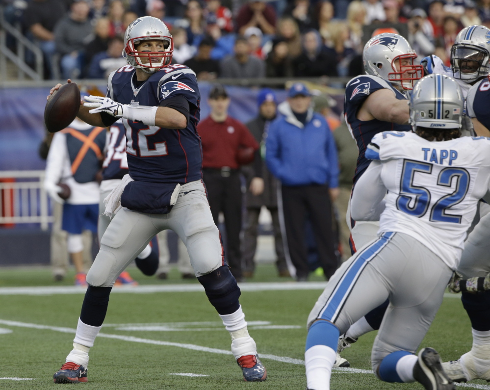 Tom Brady throws a pass against the Detroit Lions on Sunday in Foxborough, Mass.  The Associated Press