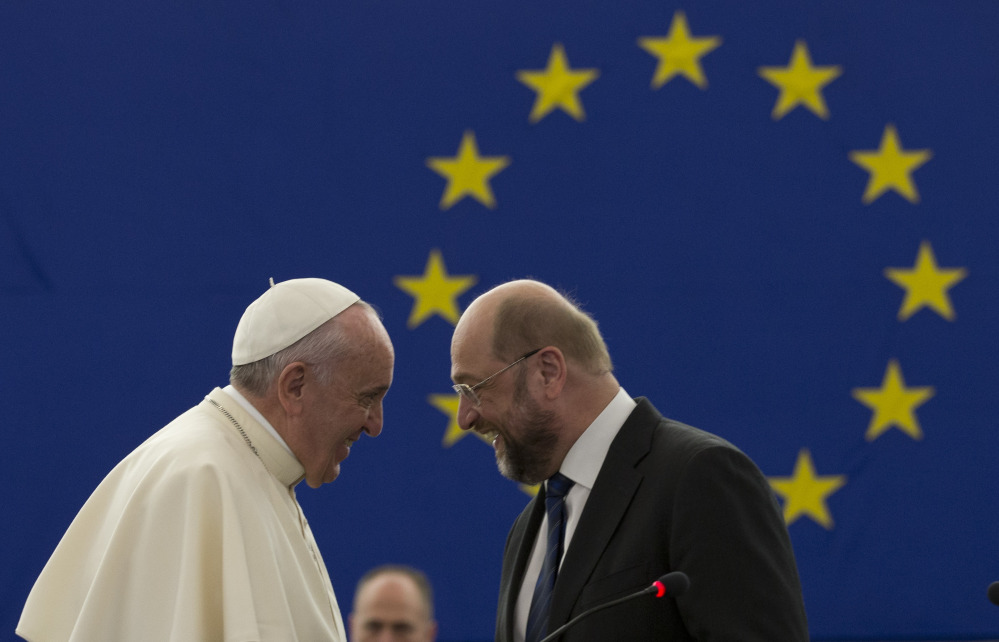 """European Parliament President Martin Schulz, right, told Pope Francis on Tuesday that """"you are a person who gives us guidance at a time when we have lost our compass."""""""