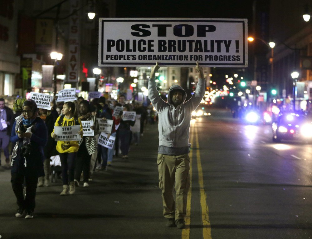 NEWARK: Cliff Rogers marches Tuesday during a rally in response to a grand jury deciding not to indict Ferguson, Mo., police Officer Darren Wilson.