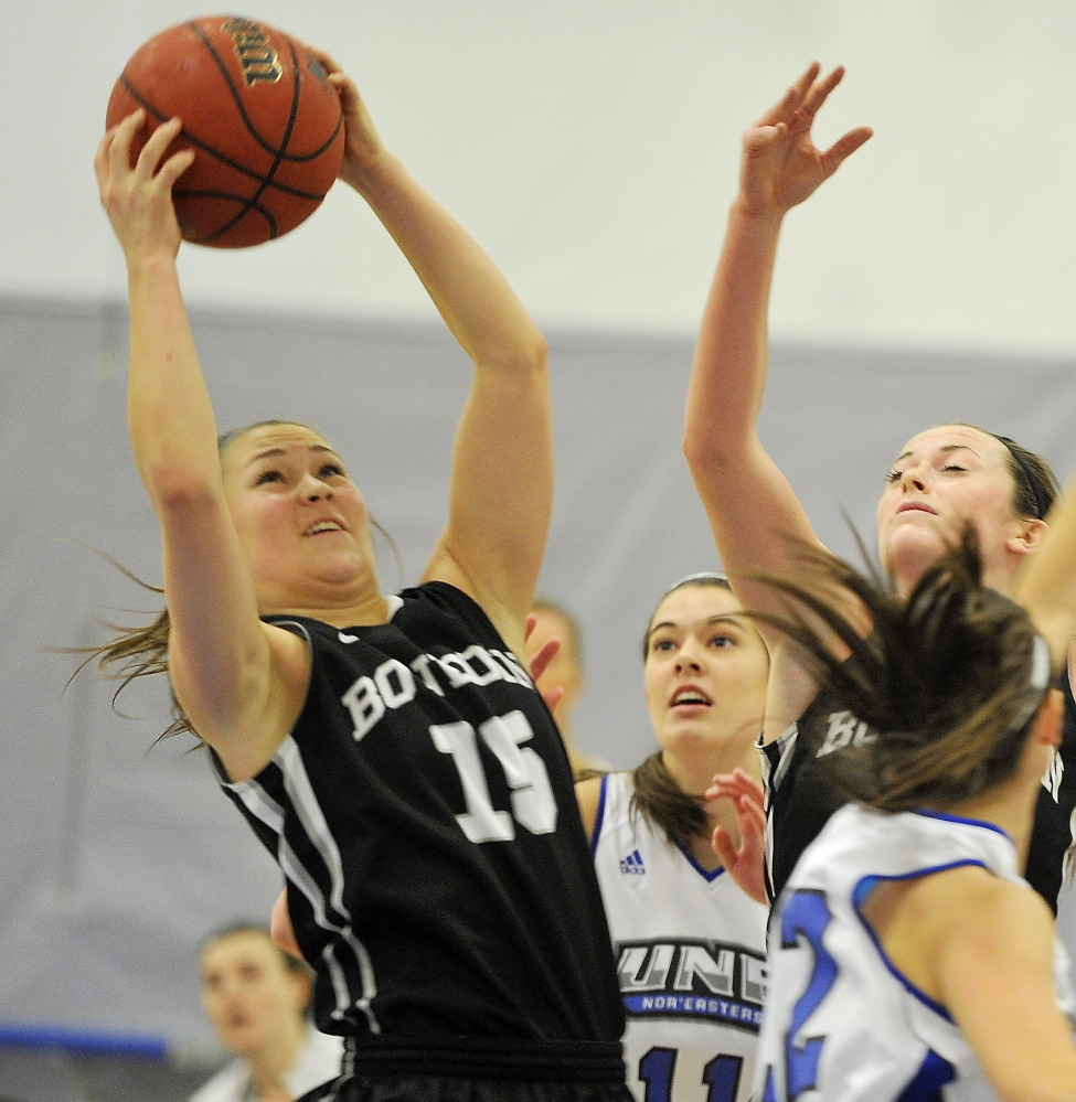 Marle Curle of Bowdoin pulls down the rebound Tuesday night during the non-conference game at the University of New England. UNE won the back-and-forth game, 68-64.