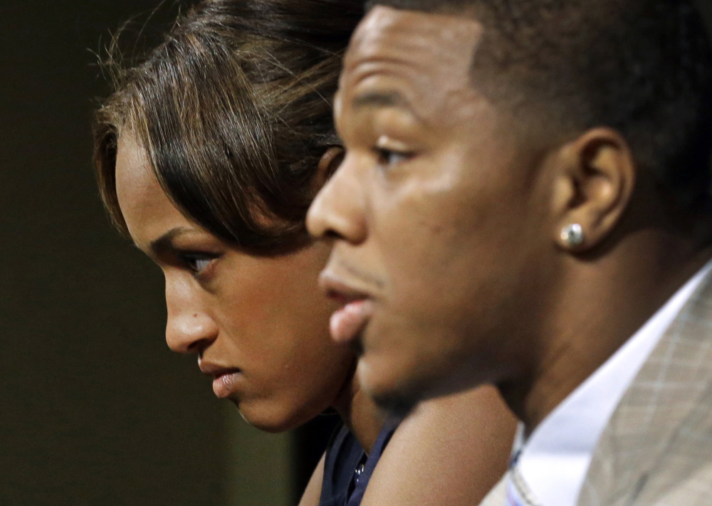 Janay Rice, left, appeared with her husband, Baltimore Ravens running back Ray Rice, at a news conference. Rice's suspension by the NFL was vacated, the players' union announced Friday.