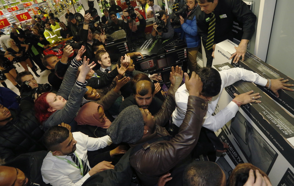 London shoppers compete to purchase items on Black Friday at an Asda superstore in Wembley.