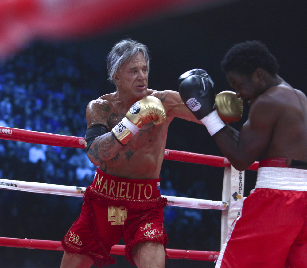 Actor Mickey Rourke, left, punches his opponent Elliot Seymour during his return to boxing in Moscow on Friday.