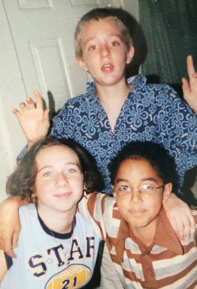 Justine DiPietro, Michael Moore and James Ford pose for a photo. The boys met as children riding the school bus and became immediate friends. Over time, they grew as close as siblings, DiPietro said.