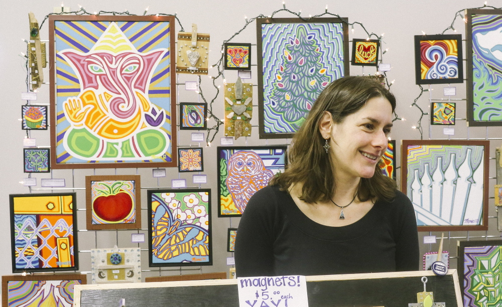 "Maria Castellano-Usery sells her acrylic paintings and mixed-media artwork at the one-day-only Artisan Pop-Up Shop at 90 Maine St. in Brunswick on Small Business Saturday. ""I heard there was a free space to show my work, so I jumped on it as soon as I heard about it,"" she said."