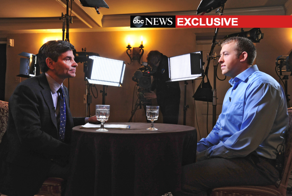 In this photo provided by ABC News, ABC News' chief anchor George Stephanopoulos, left, interviews Ferguson, MO., police officer Darren Wilson, Nov. 25, 2014 in Missouri.