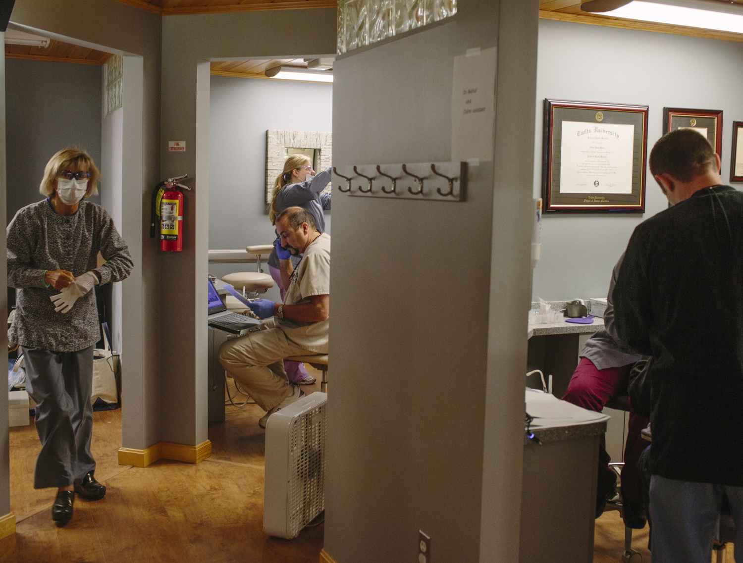 Dentists and dental assistants work on patients' teeth during the Dentists Who Care for ME clinic, which provides free dental health care for patients in Maine who cannot afford it, at the Dunstan Dental Center in Scarborough on Friday.