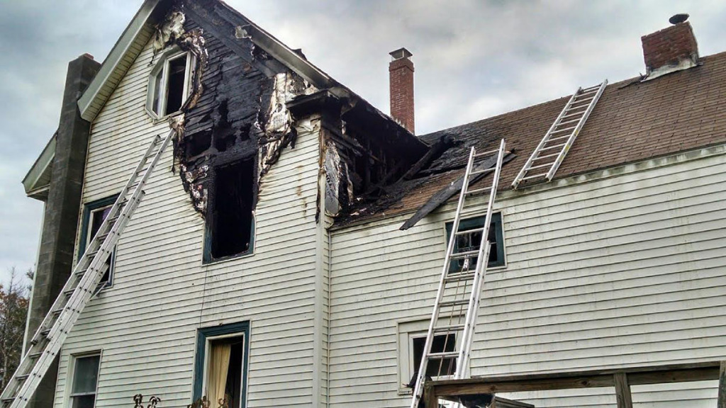 Fire damage was confined to the rear of the building, though smoke damaged the interior throughout the home. New Gloucester Fire & Rescue photo