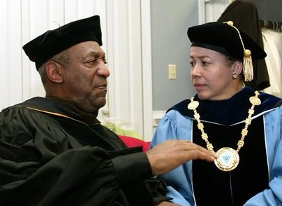 Bill Cosby and Spelman College President Dr. Beverly Tatum talk before the start of commencement at the school in Atlanta in this May 14, 2006, photo. The Associated Press