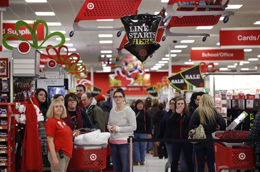 Target shoppers wait to check out on Black Friday in South Portland. The store opened at midnight.
