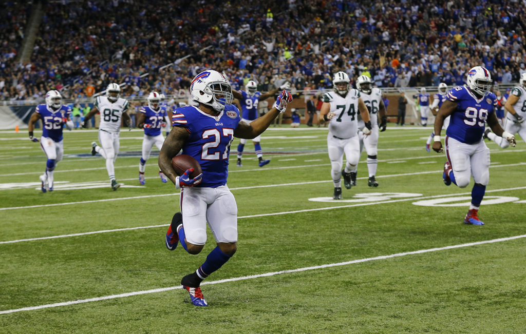 Buffalo Bills strong safety Duke Williams returns an interception pass thrown by New York Jets quarterback Michael Vick and returns it for 16-yards during the second half of an NFL football game in Detroit, Monday. The Associated Press