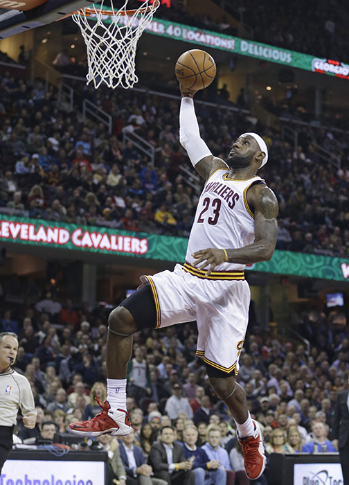Cleveland Cavaliers' LeBron James drives to the basket against the Orlando Magic on Monday in Cleveland.