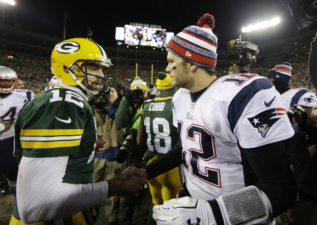 Green Bay Packers' Aaron Rodgers shakes hands with New England Patriots' Tom Brady after an NFL football game Sunday, in Green Bay, Wis. The Packers won 26-21. The Associated Press