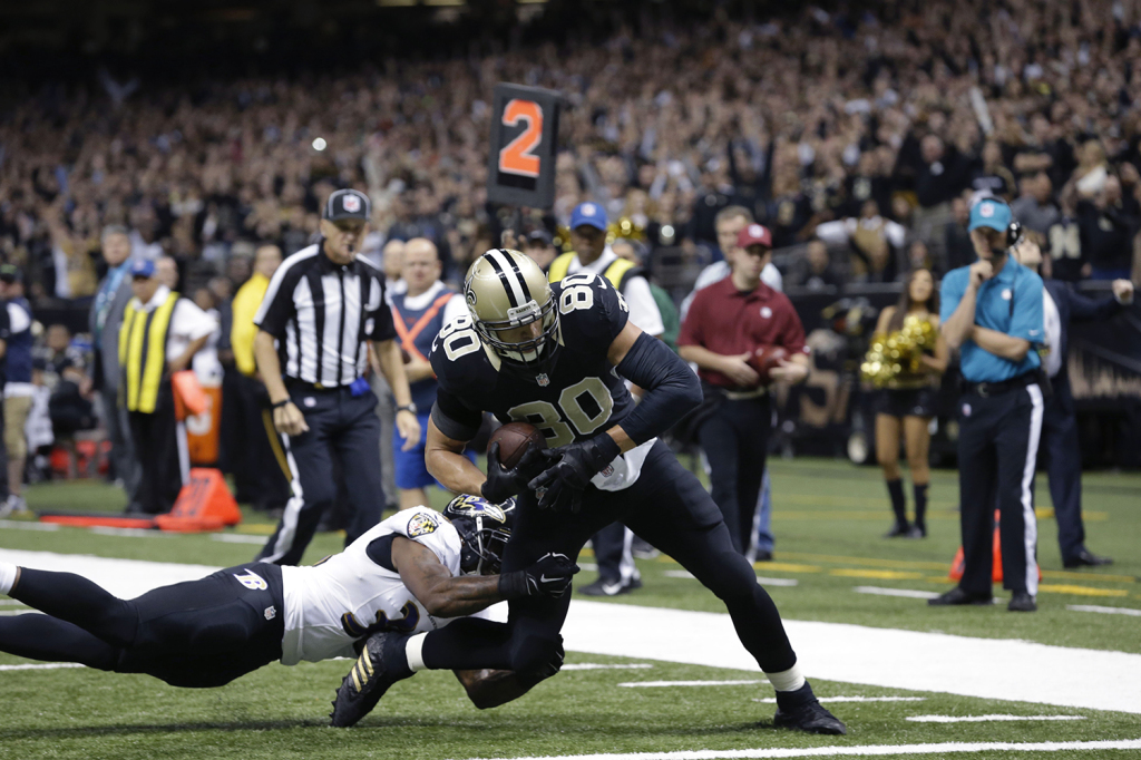 New Orleans Saints tight end Jimmy Graham (80) scores a touchdown reception in the first half of an NFL football game against the Baltimore Ravens in New Orleans, Monday. The Associated Press