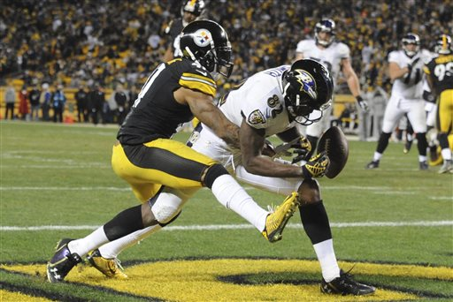 Baltimore Ravens wide receiver Torrey Smith (82) can't make a catch as Pittsburgh Steelers defensive back Antwon Blake (41) defends in the fourth quarter Sunday in Pittsburgh.  The Associated Press