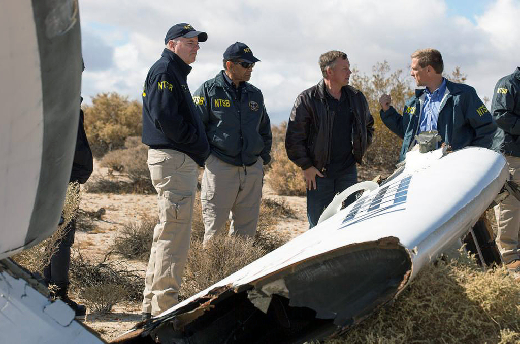 Virgin Galactic pilot Todd Ericson, right, talks with National Transportation Safety Board Acting Chairman Christopher A. Hart, second from left, at the SpaceShipTwo accident site with investigators in Mojave, Calif., on Saturday. Investigators have found that the