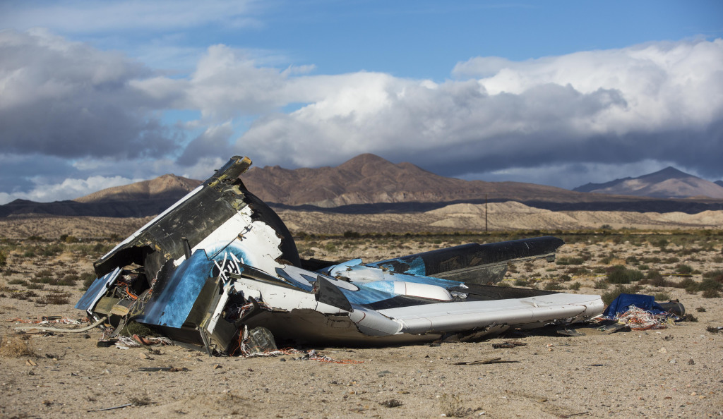 Wreckage lies near the site where a Virgin Galactic space tourism rocket, SpaceShipTwo, exploded and crashed in Mojave, Calif. The Friday explosion killed a pilot aboard and seriously injured another while scattering wreckage in Southern California's Mojave Desert, witnesses and officials said. The Associated Press