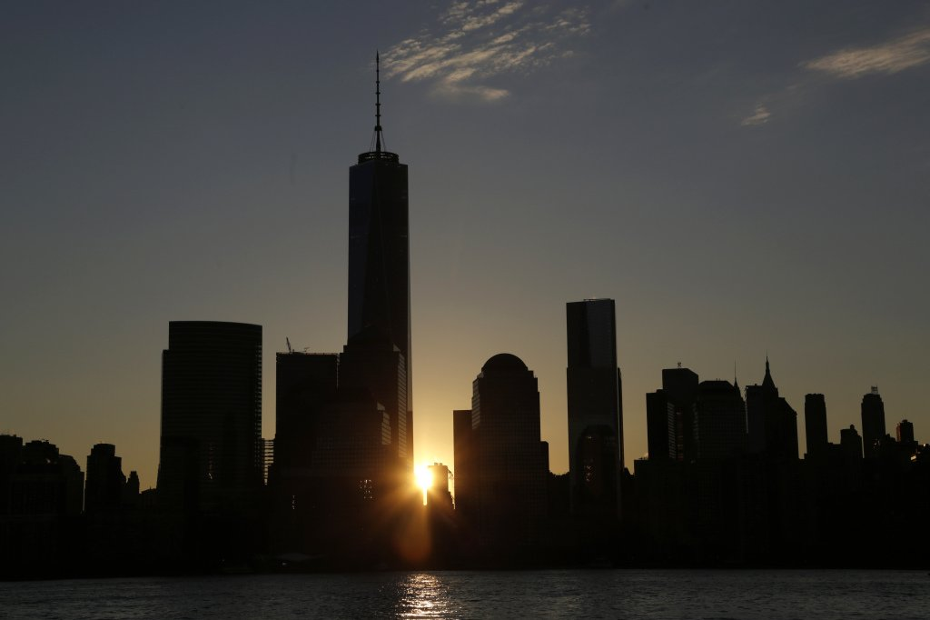 One World Trade Center dominates the lower Manhattan skyline at sunrise as seen from Jersey City, N.J., on Monday. It is America's tallest building. The Associated Press