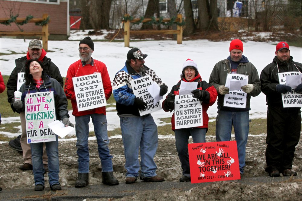 Striking FairPoint workers sing Christmas carols outside the Winslow home of Mike Reed, state president for FairPoint in Maine, on Tuesday.