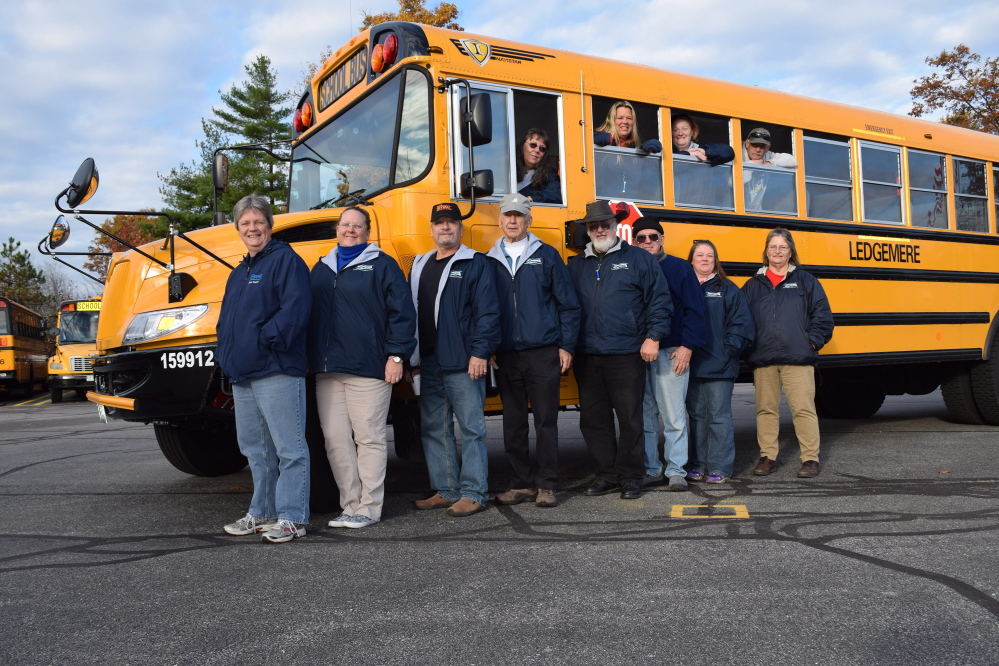 The Parent Teacher Student Association at Wells Elementary School sponsored a Bus Driver Appreciation Week to acknowledge and thank bus drivers. Among those honored were, inside bus from left, Jean LaRiviere, Christine Towne, Tabitha Bergeron and Richard Bissell, and, standing outside bus, from left, Lauren Clark, Rochelle Greenwood, Bill Cochran, Joe Nugent, Dan Hungerford, John Harris, Tammy Bissell and Debbie Carmel. Reg Bennett photo