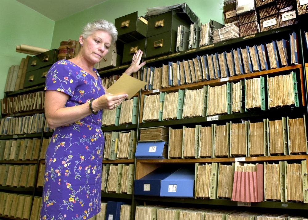 Linda Cohen, shown retrieving a document when she was Portland's city clerk in 2002, has won awards for her integrity and professionalism and is president of the South Portland/Cape Elizabeth Chamber of Commerce.