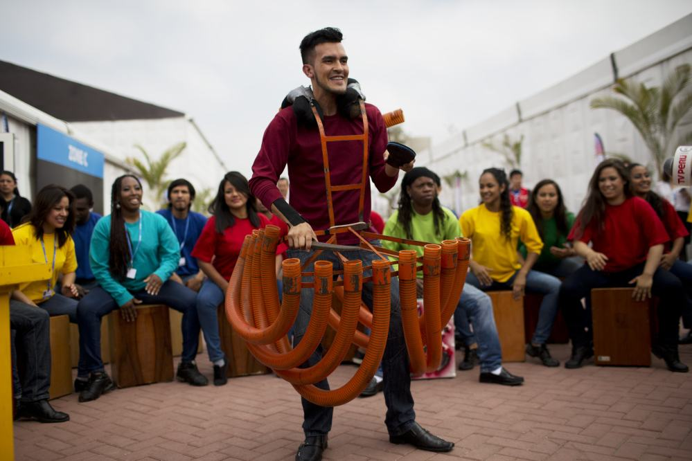 Artists perform during the inauguration of Climate Change Conference in Lima, Peru, on Monday. Delegates from more than 190 countries will meet in Lima for two weeks to work on drafts for a global climate deal that is supposed to be adopted next year in Paris.