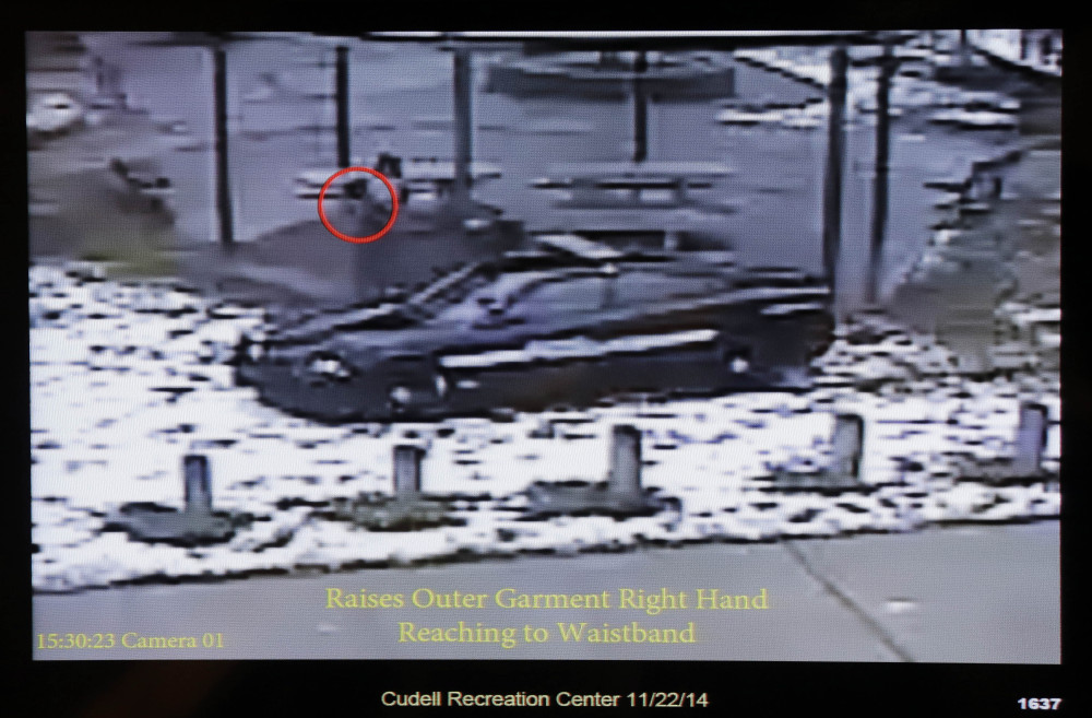 This still image taken from a surveillance video played at a news conference held by Cleveland Police, Wednesday, Nov. 26, 2014, shows Cleveland police officers arriving at Cudell Park on a report of a man with a gun.