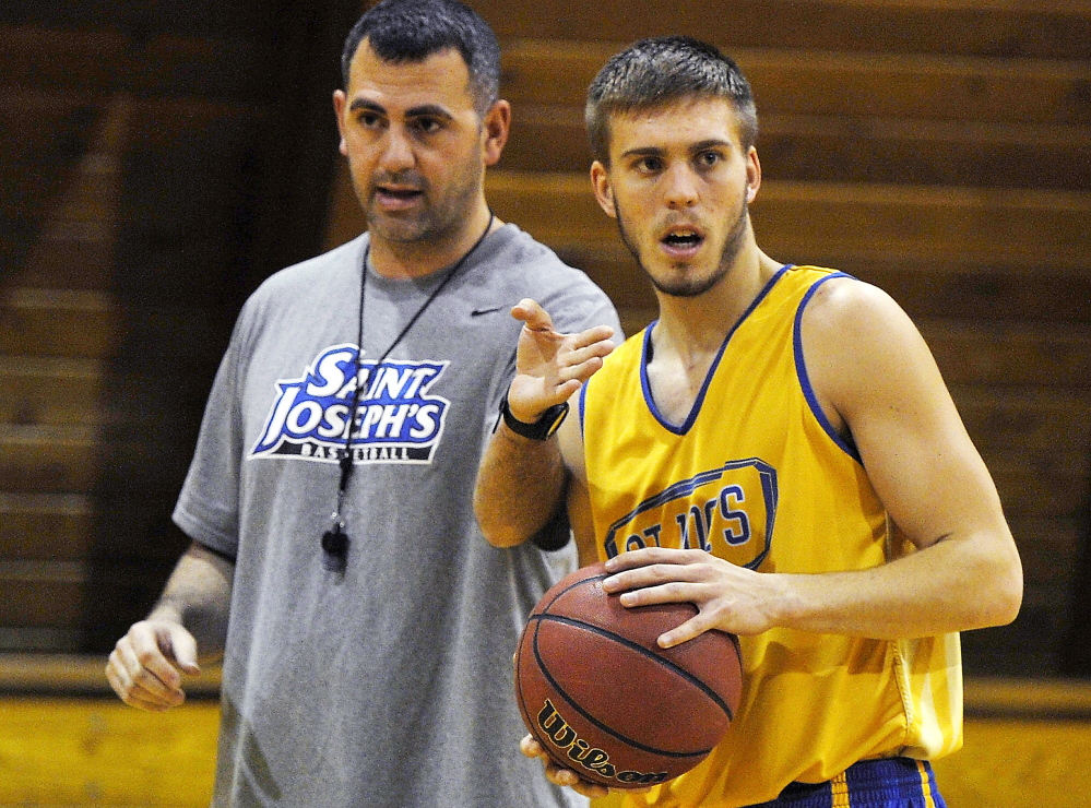Rob Sanicola, left, used to baby-sit Steven Simonds, but now he gets to coach him for a fourth year at St. Joseph's College.
