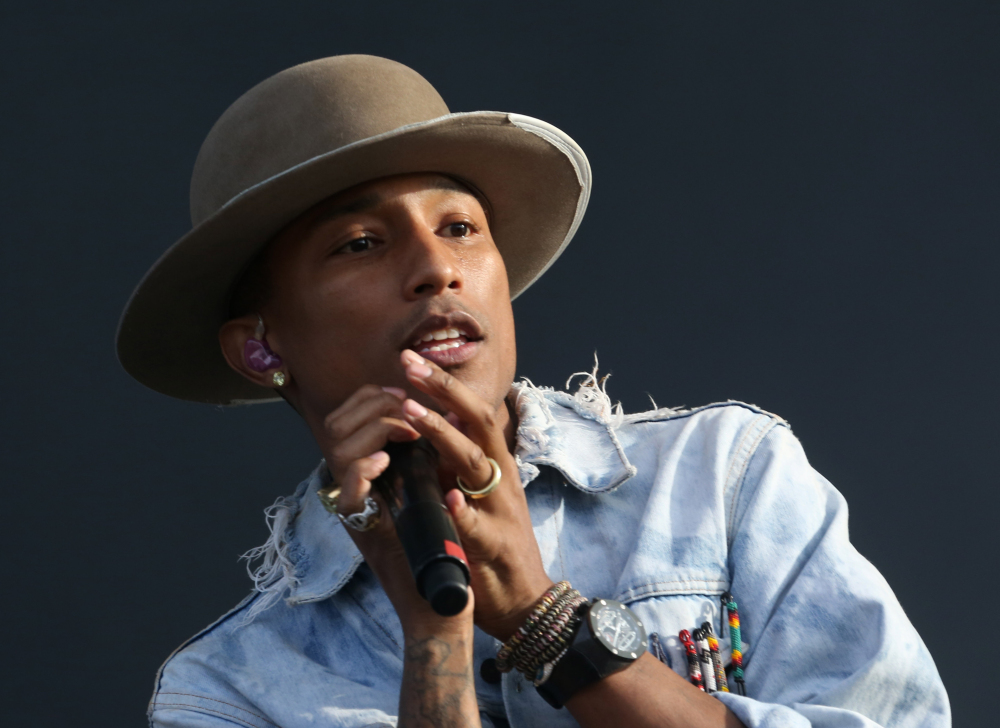 """Pharrell Williams says """"everyone is heartbroken"""" after there was no grand jury indictment of a white police officer in the killing of a black Missouri teen."""