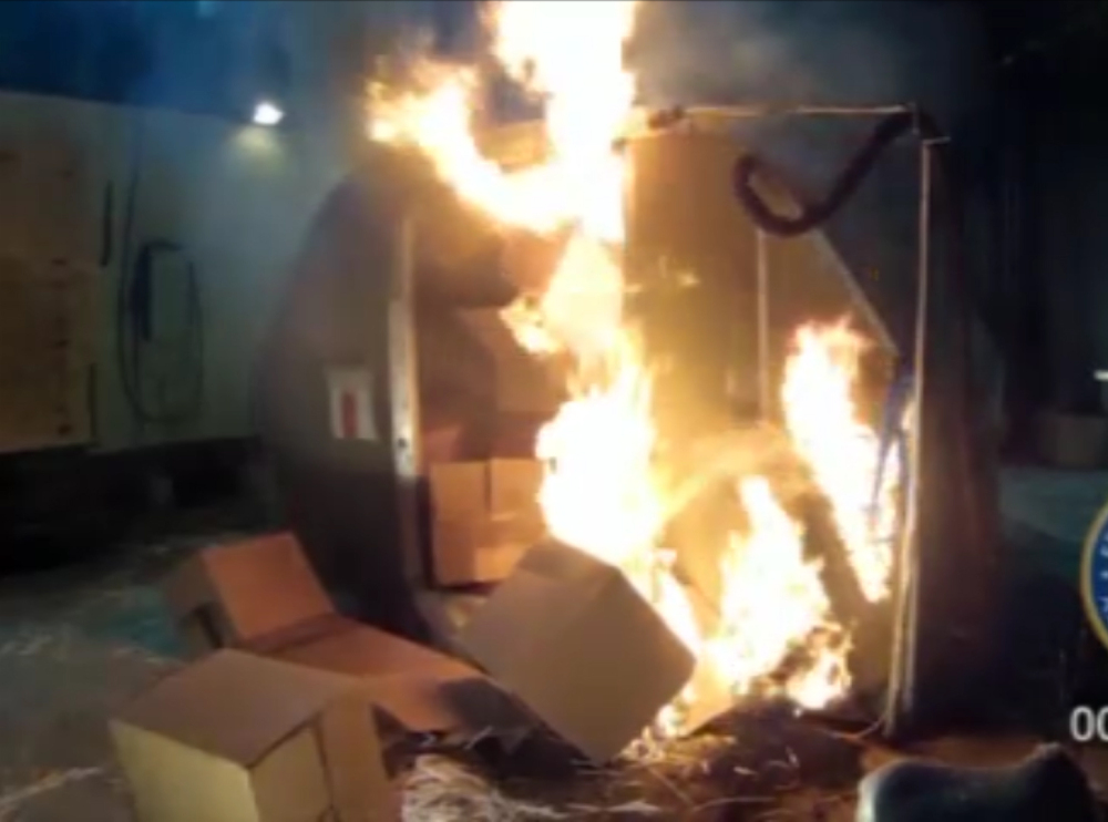 This frame grab shows the results of a test at the FAA's technical center in Atlantic City, N.J., after a cargo container was packed with 5,000 lithium-ion batteries. The batteries power products from cellphones and laptops to hybrid cars.