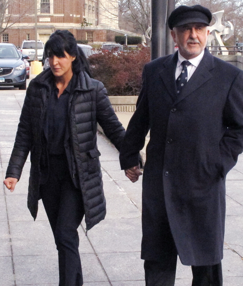 Tiffany Stevens walks with her father, Edward Khalily, to Hartford Superior Court in Hartford, Conn., on Tuesday. The alleged murder-for-hire plot in 2012 occurred as she and her ex-husband were involved in a child custody dispute.