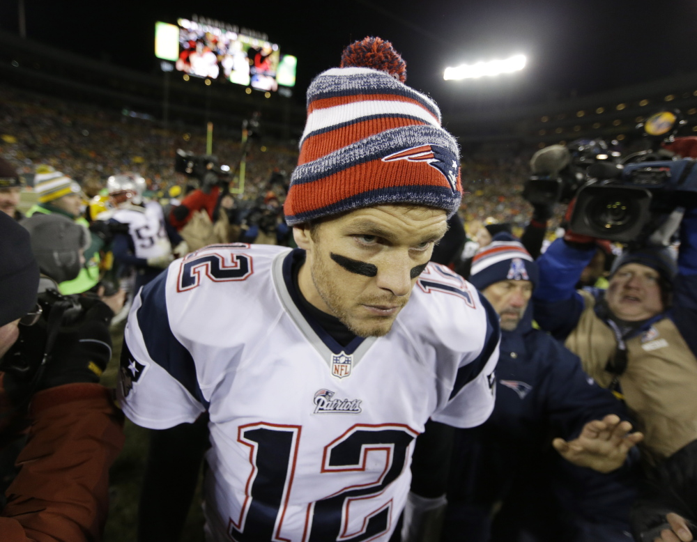 New England Patriots' Tom Brady walks off the field after Sunday's game against the Green Bay Packers.