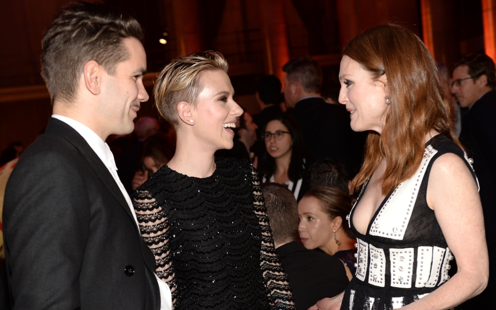 Romain Dauriac, Scarlett Johansson, center, and Julianne Moore attend the Gotham film awards Monday in New York.