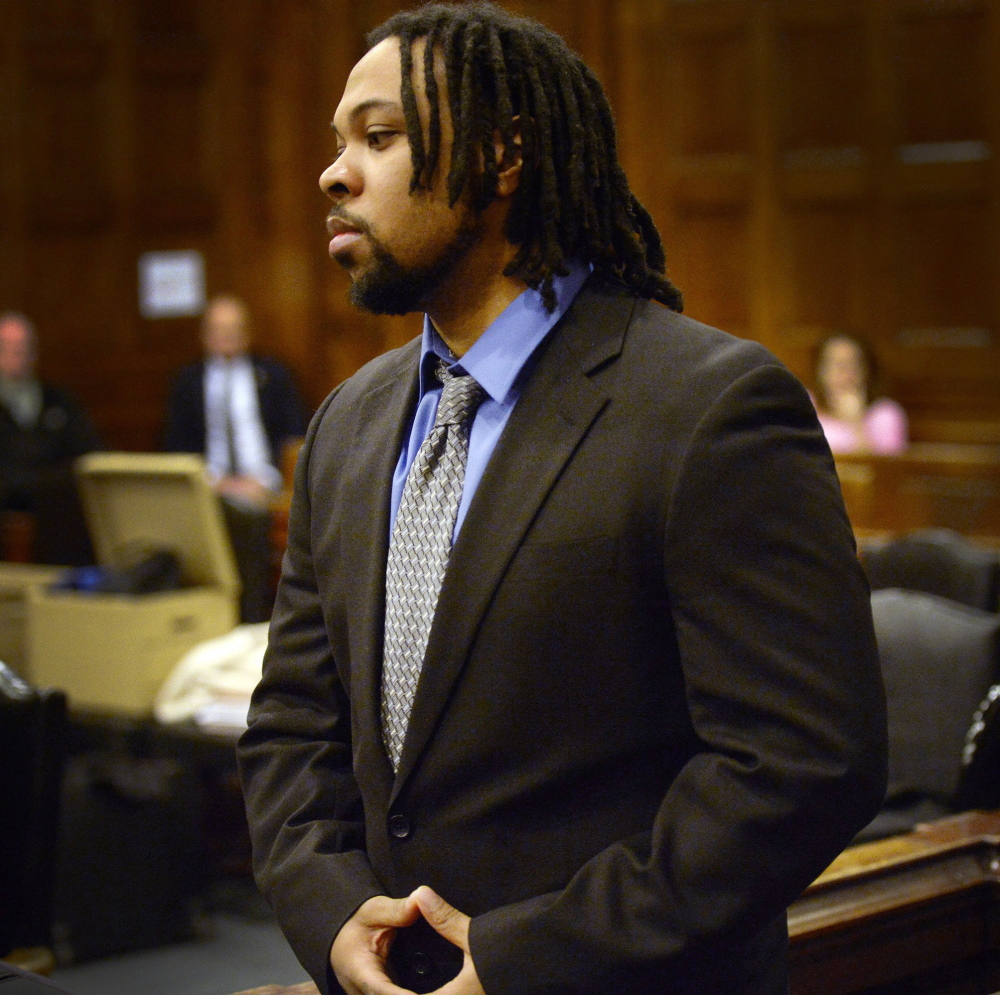 Tareek Hendricks, seen in court Tuesday, is accused of fatally stabbing Robert Stubbs and injuring Melissa Stubbs with the same knife in their duplex apartment in Westbrook.