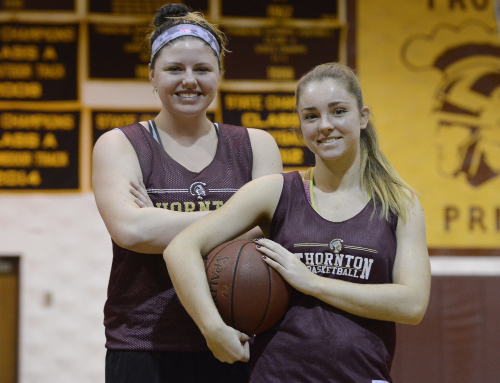 Victoria Lux, left, and Katie McCrum played together on the Maine Firecrackers AAU team. Now they're teammates at Thornton Academy, with Lux transferring from McAuley, where she helped win three state titles.
