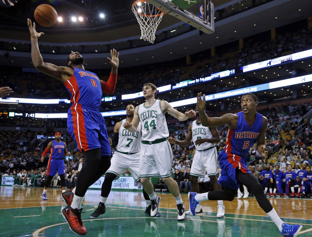 Detroit Pistons guard Kentavious Caldwell-Pope watches as center Andre Drummond gathers in a rebound against Boston Celtics center Tyler Zeller (44) and forward Jared Sullinger during the first half of Wednesday night's game in Boston.
