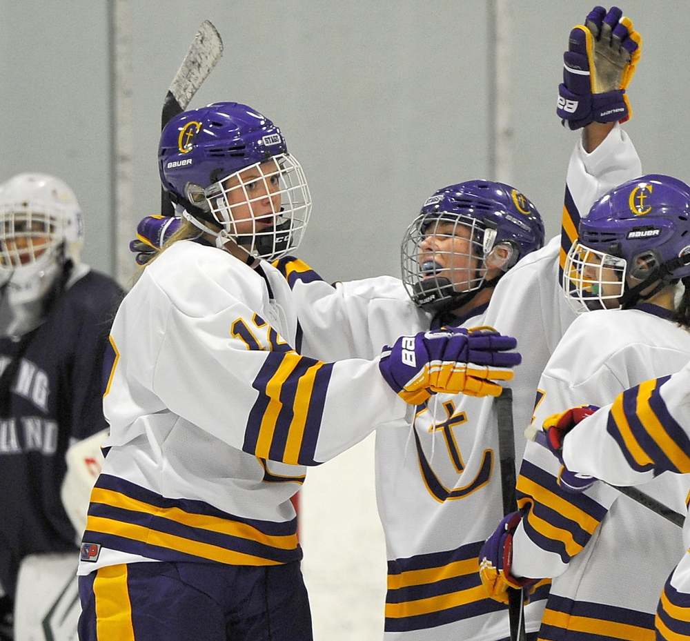 Caroline Ray, left, and Jill Hannigan of Cheverus celebrate Wednesday following a goal during an 8-2 victory against Portland/Deering in a schoolgirl hockey game at the Portland Ice Arena.