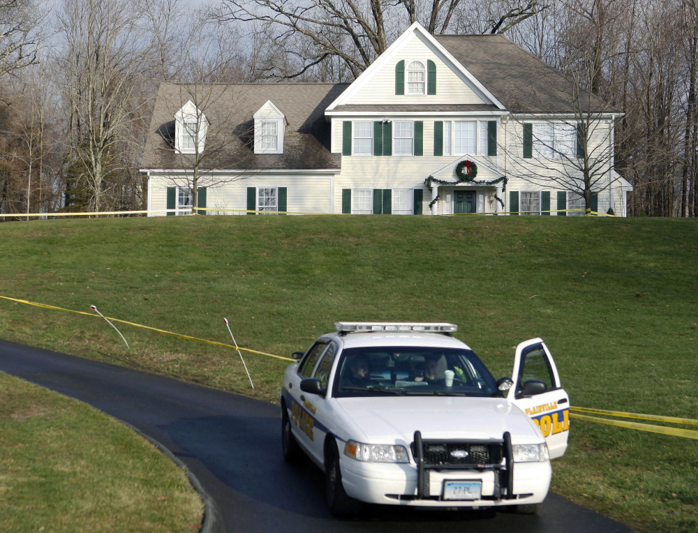 A police cruiser sits in the driveway of the Newtown, Conn., home where Sandy Hook Elementary School gunman Adam Lanza lived with his mother on Dec. 18, 2012.