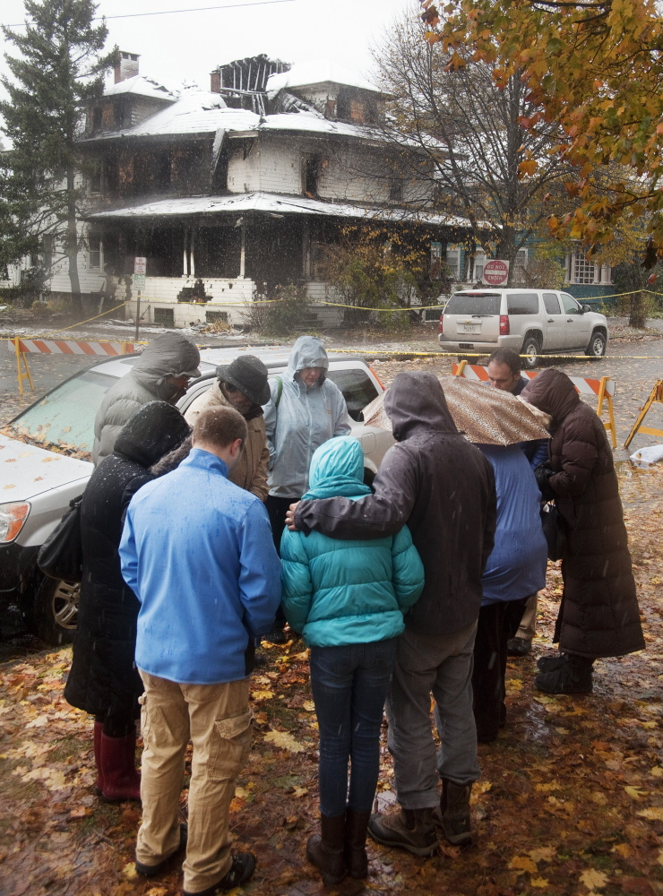 People gather across from 20 Noyes St. the day after the fire on Nov. 1 killed six people. It was Maine's deadliest fire in 40 years. Landlord Gregory Nisbet has not responded to repeated requests for comment about his management of the duplex, and his attorney has declined to comment.