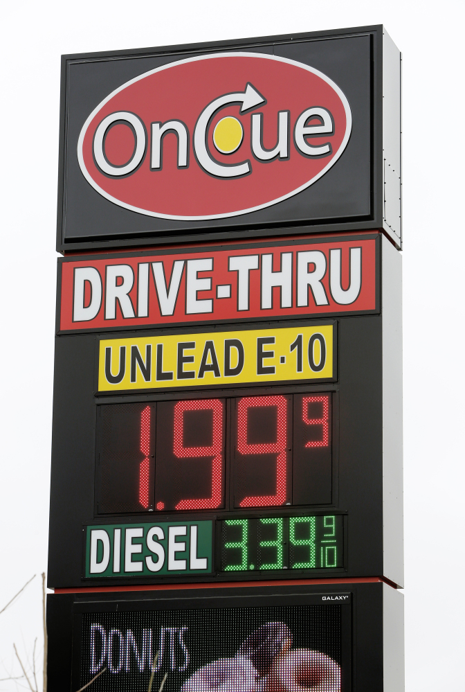 A sign displays the price for E-10 gasoline for $1.99 at the OnCue convenience store and gas station Wednesday in Oklahoma City. The Associated Press