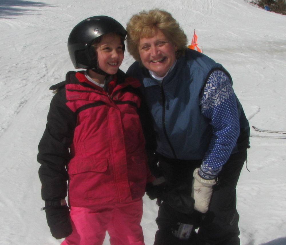 Cindy Dubois, right, a volunteer with Central Maine Adaptive Sports, teaches Jaclyn Sweet to ski at Lost Valley.