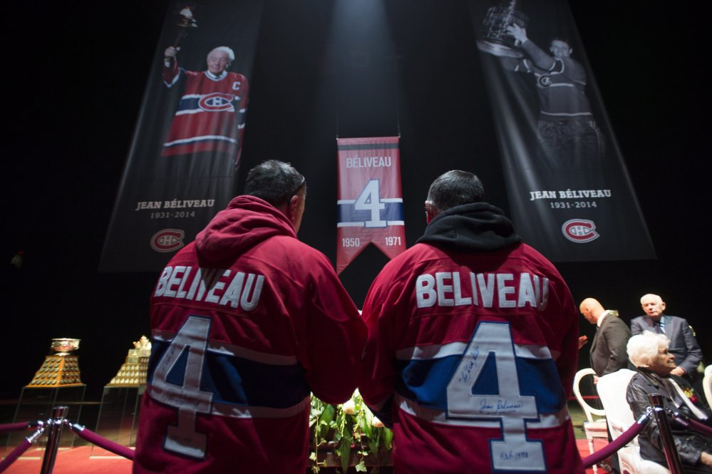 Mourners file past the casket to pay their respect during the public viewing for the Montreal Canadiens legend Jean Beliveau on Sunday in Montreal.