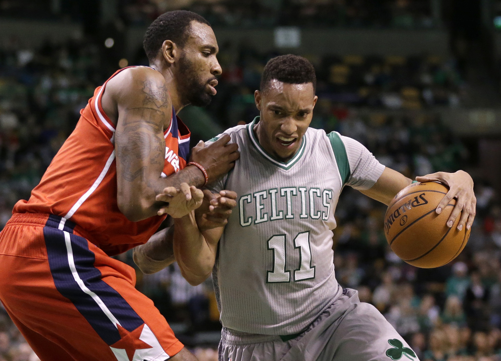 Guard Evan Turner of the Celtics tries to drive past Washington's Rasual Butler in the second quarter Sunday in Boston. The Celtics won 101-93 for their third straight win.