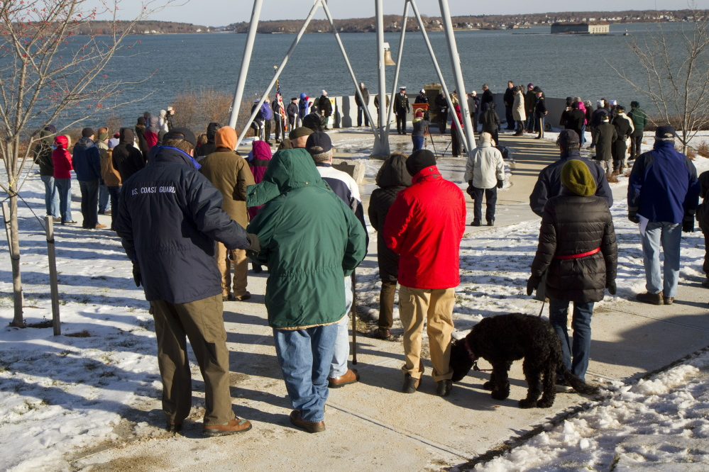 People gather at Fort Allen Park in Portland on Sunday to commemorate the anniversary of the Pearl Harbor bombing. Carl D. Walsh/Staff Photographer